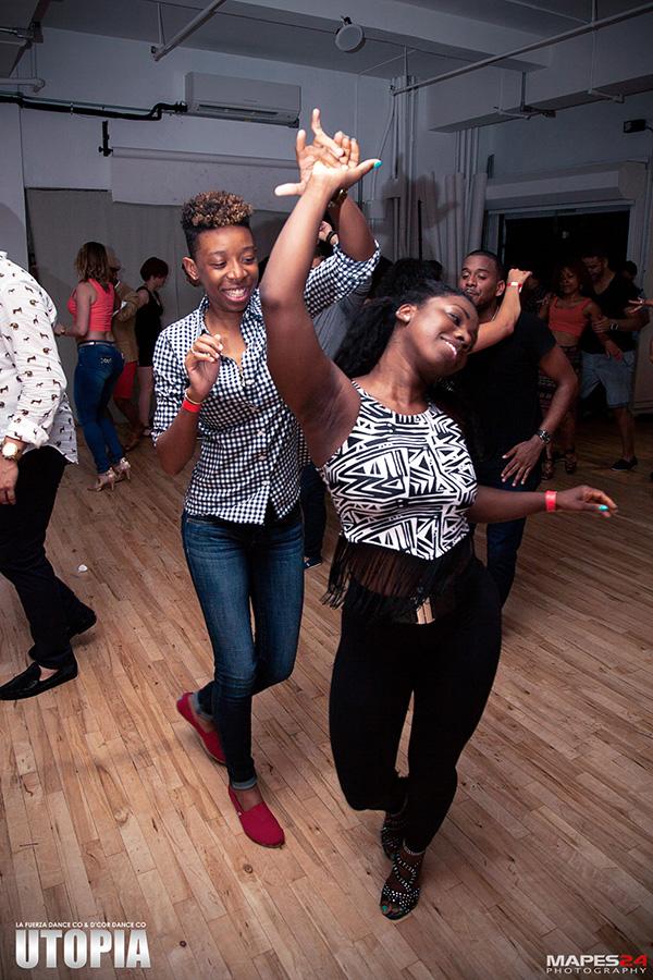 couple social dancing bachata at utopia