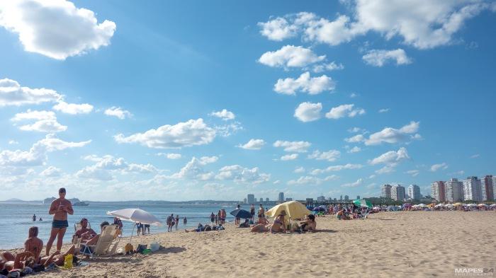 beachgoers relaxing at playa mansa