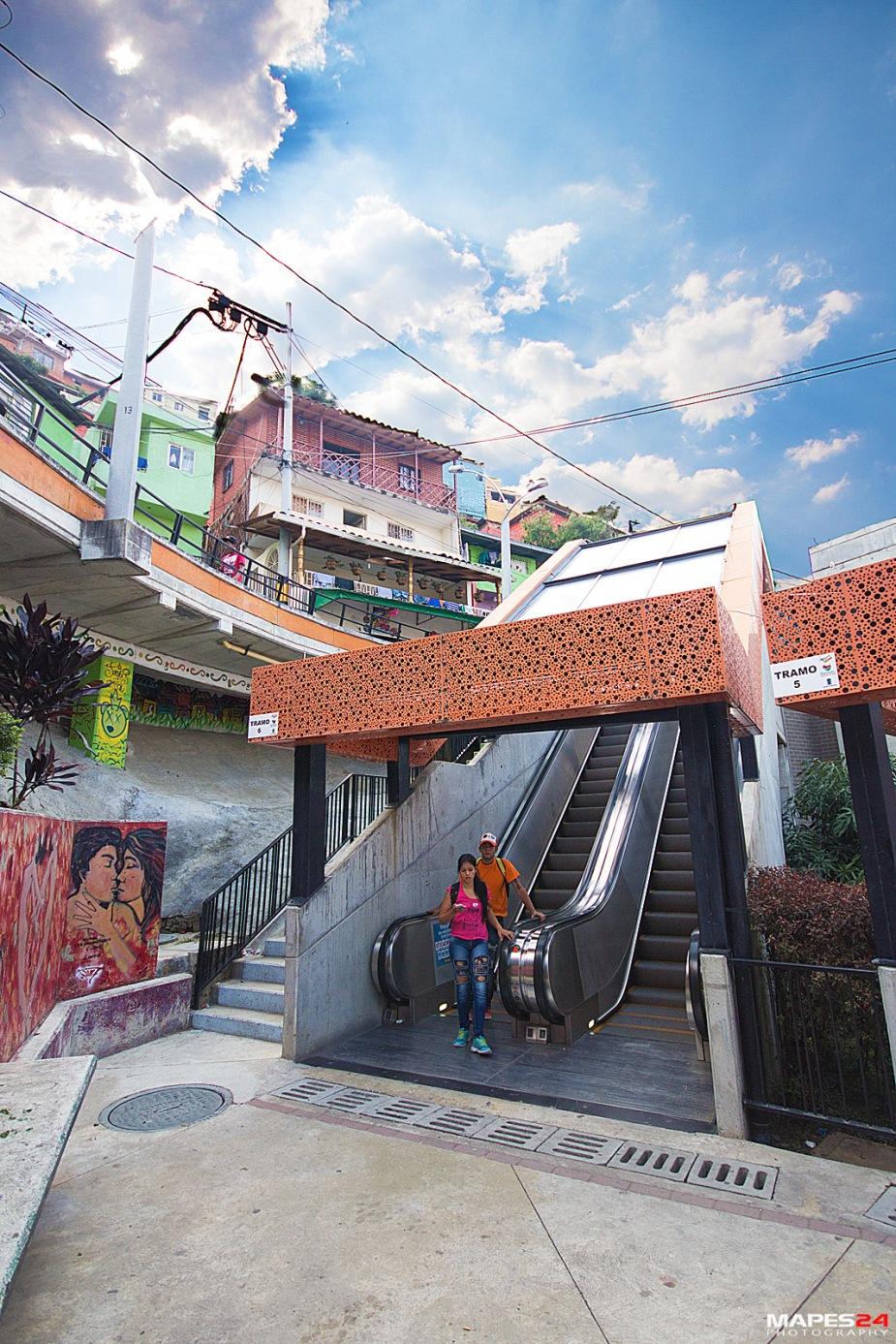 colombian teens taking escalator in comuna 13 in medellin colombia