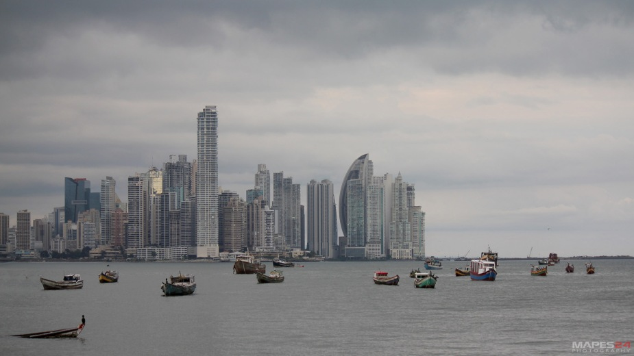 fishing boats in panama city harbor against cityscape