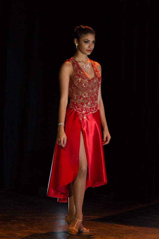 female tango dancer in red dress preparing for competition